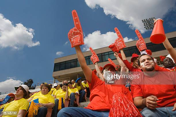 happy fans and unhappy fans - foam finger stock photos and pictures