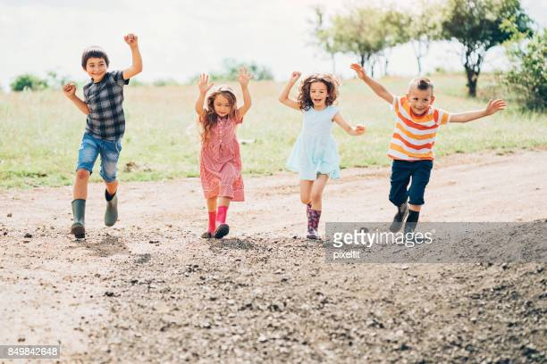Happy farm children outdoors in the summer