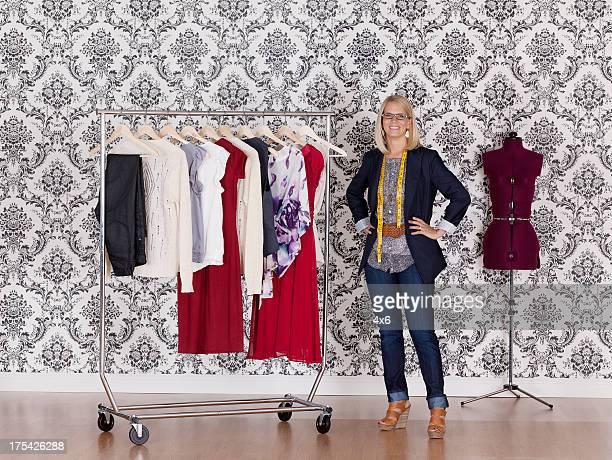 Happy fashion designer standing in her workshop