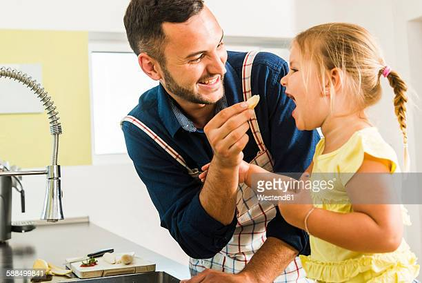 Happy father and daughter in kitchen