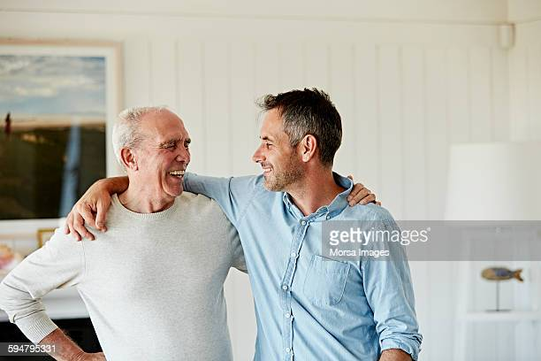 happy father and son at home - oudere mannen stockfoto's en -beelden