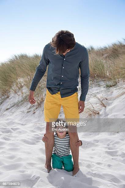 Happy father and son enjoying on beach