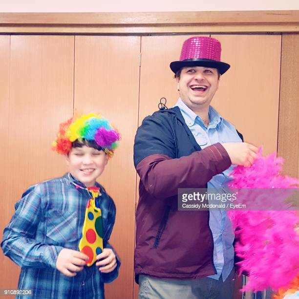 Happy Father And Son In Costume