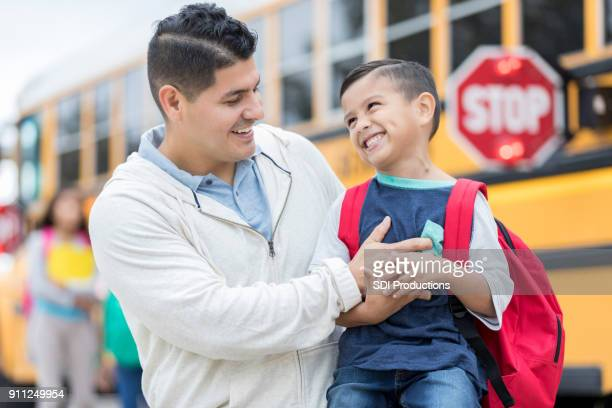 happy father and son in front of school bus - back to school stock pictures, royalty-free photos & images