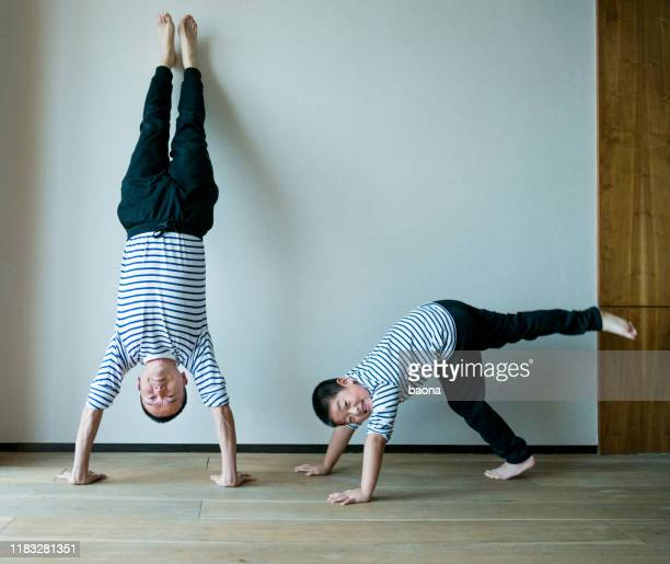 happy father and son - striped pants stock pictures, royalty-free photos & images