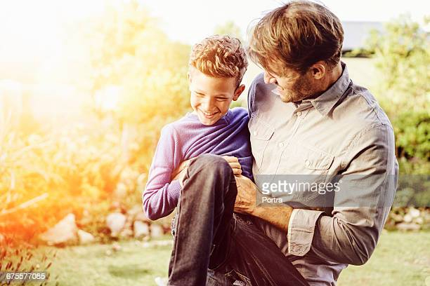 Happy father and son playing at park