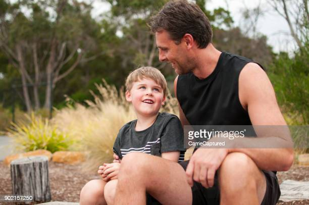 happy father and son sitting together - uncle stock photos and pictures