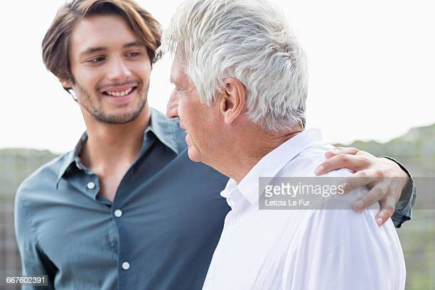 Happy father and son talking outside