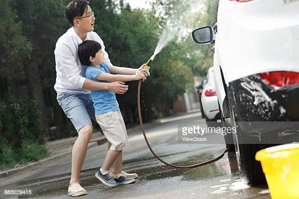 Happy father and son to clean the car