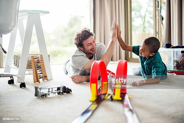 Happy father and son while playing games