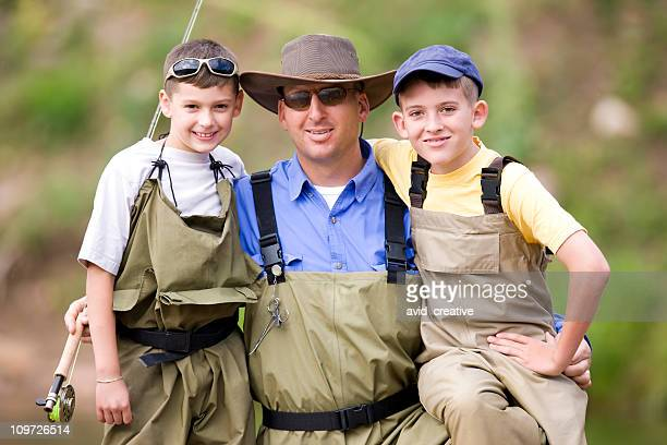 Happy Father and Sons Fishing Together