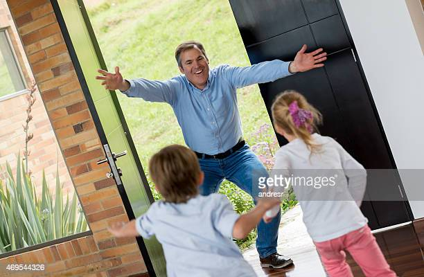 Happy father arriving home