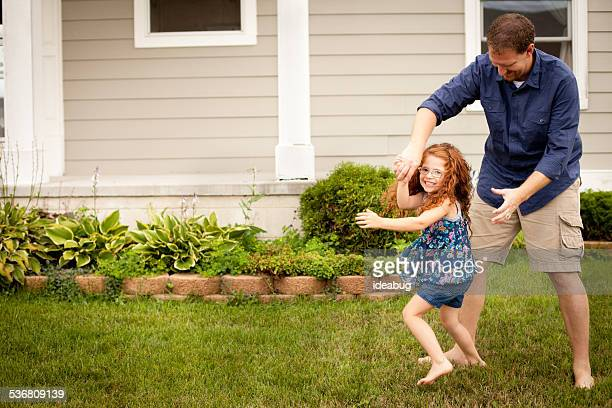 Happy Father Dancing with His Daughter Outside
