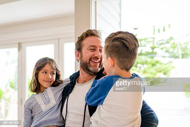 happy father greeting his children - arrival stock pictures, royalty-free photos & images