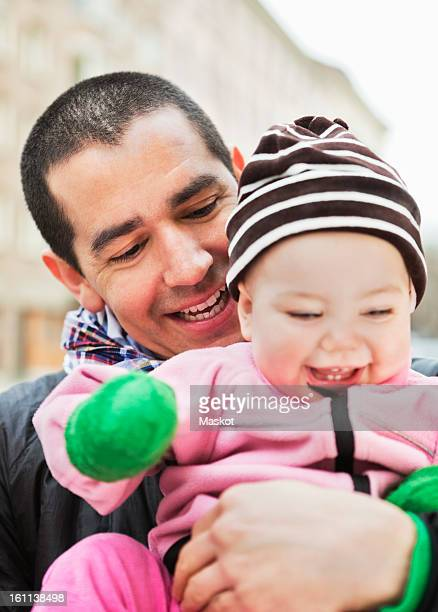 happy father holding laughing baby (0-11 months) - 0 11 monate stock-fotos und bilder