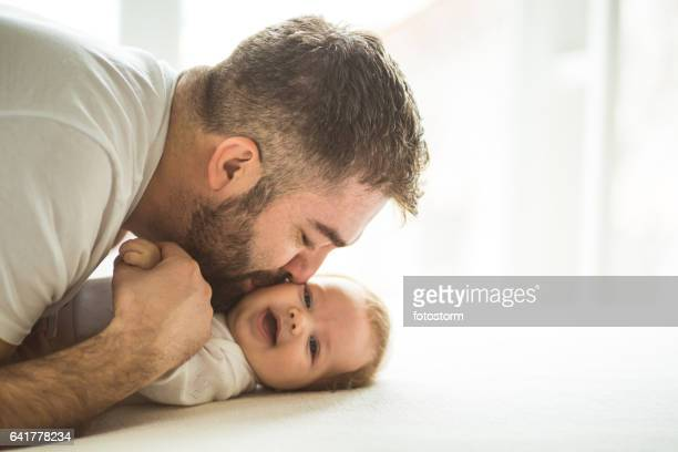 Happy father kissing baby girl