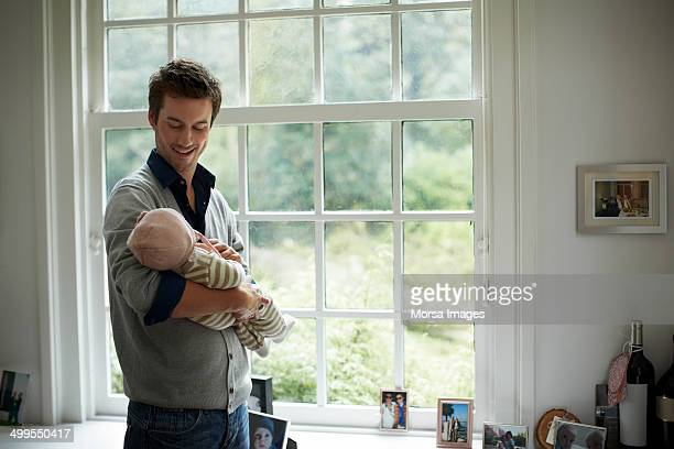 happy father looking at baby - new life stock pictures, royalty-free photos & images