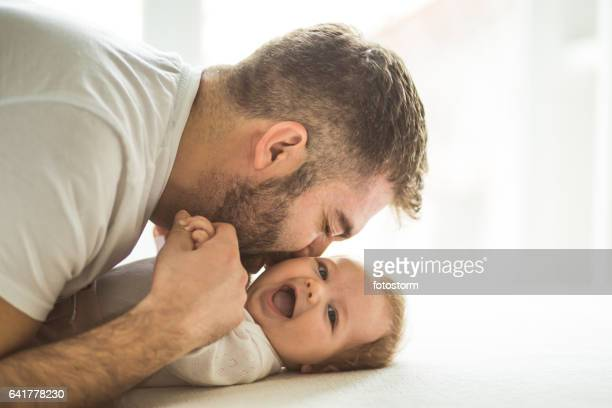 Happy father playing with his daughter