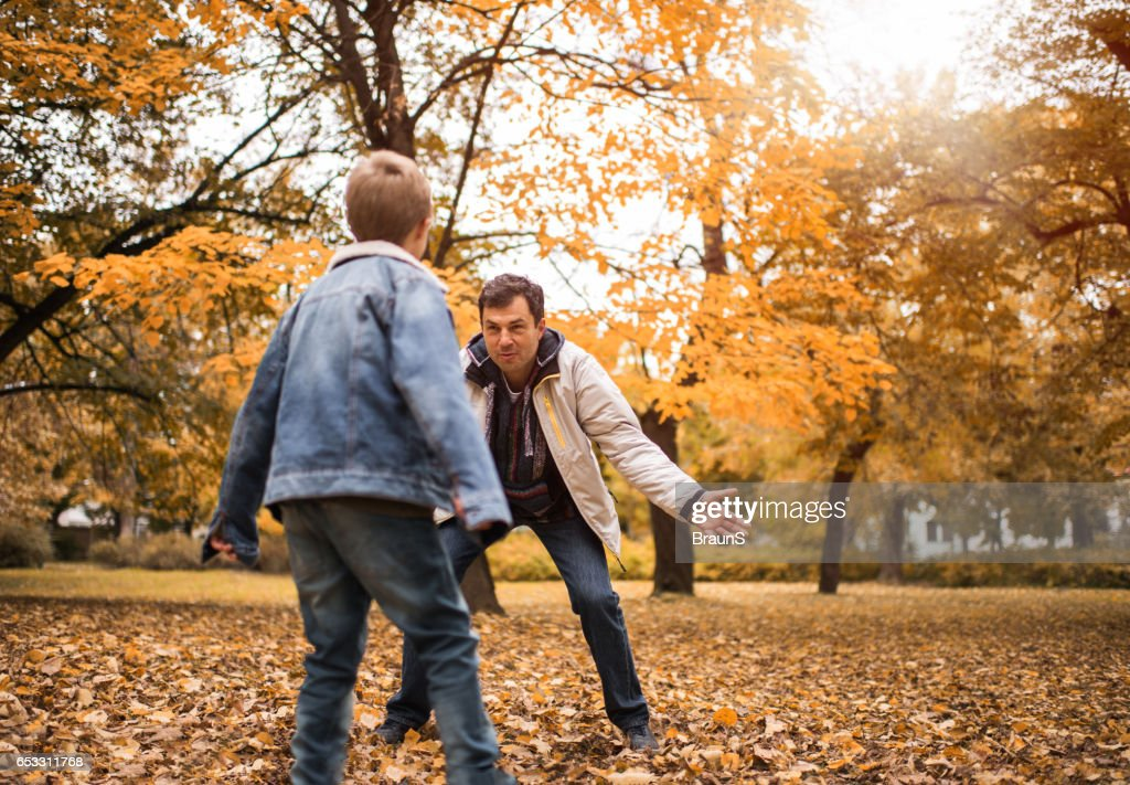 Happy father playing with his son in the park. : Stock Photo