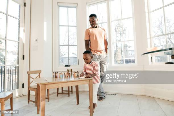 Happy father playing with toddler son