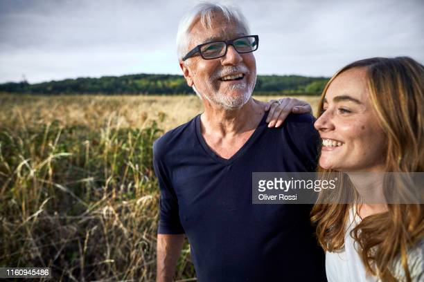 happy father with adult daughter at a field in the countryside - daughter stock pictures, royalty-free photos & images