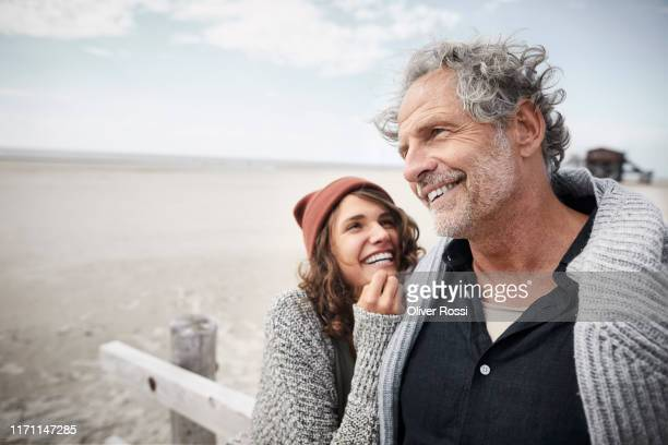 happy father with adult daughter on the beach - adults only stock pictures, royalty-free photos & images