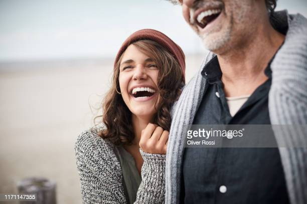 happy father with adult daughter on the beach - freedom stock pictures, royalty-free photos & images