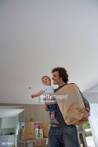 Happy father with baby, shopping