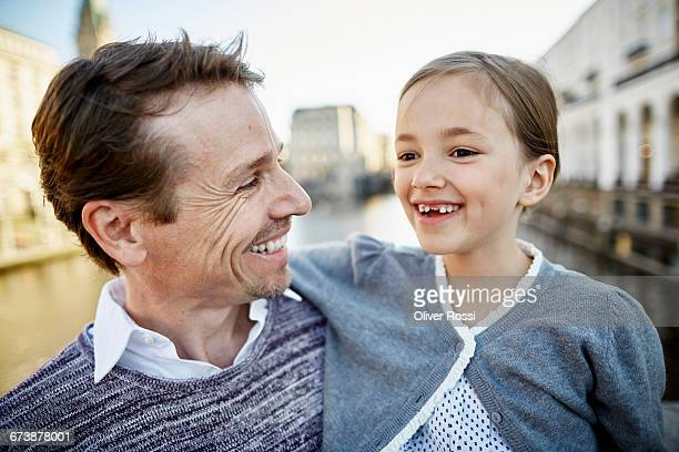 Happy father with daughter outdoors