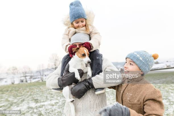 happy father with two children and dog in winter landscape - froid humour photos et images de collection