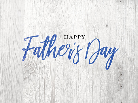 Happy Father's Day Blue Calligraphy Script Over White Wood 961061216
