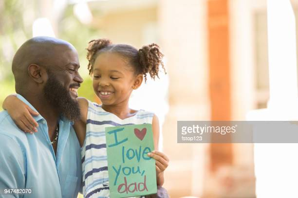 happy father's day. girl gives card to dad. - fathers day stock pictures, royalty-free photos & images