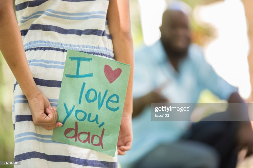 Happy Father's Day. Girl gives card to dad. : Stock Photo
