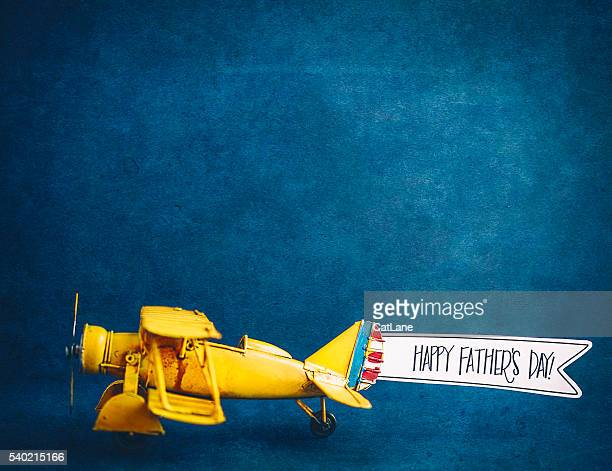 happy father's day! vintage airplane with handmade banner - fathers day stock pictures, royalty-free photos & images