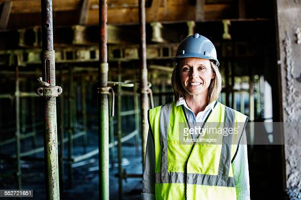 happy female architect at construction site - da cintura para cima imagens e fotografias de stock