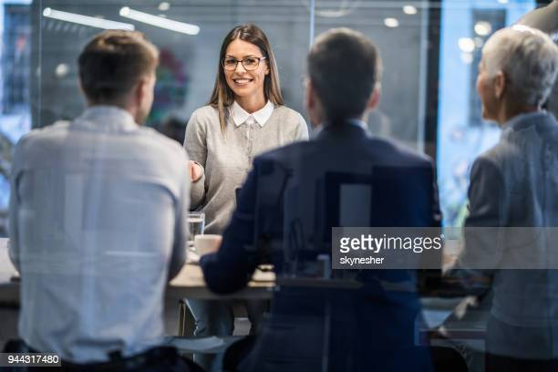 happy female candidate talking to human resource team on a job interview. - job search stock pictures, royalty-free photos & images