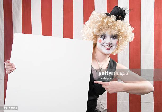 happy female clown pointing at empty sign - happy clown faces stock photos and pictures