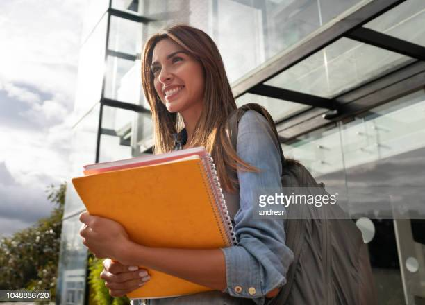 happy female college student smiling - academy stock pictures, royalty-free photos & images