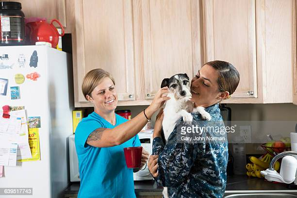 Happy female couple with their dog at home