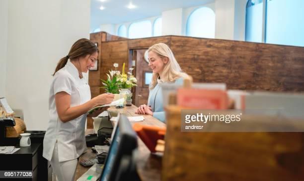 Happy female customer at a spa