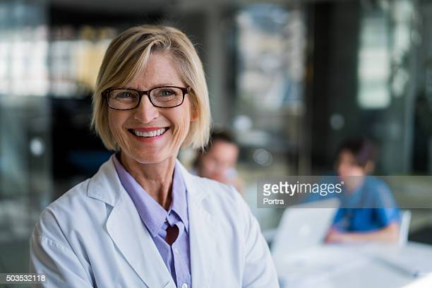 happy female doctor in hospital - female doctor stock photos and pictures