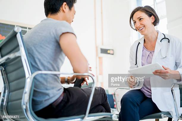 Happy female doctor with patient in hospital