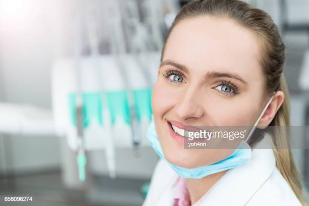 Happy female doctor with surgical mask