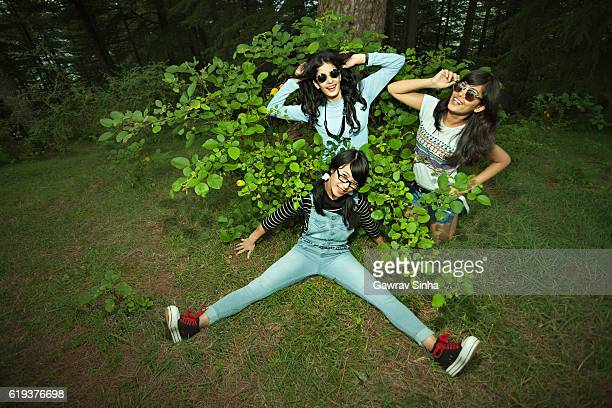 happy female friends doing fun and posing in nature. - legs spread woman stock photos and pictures