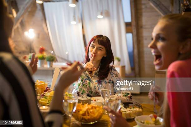 happy female friends having dinner at home together - intimate dinner fotografías e imágenes de stock