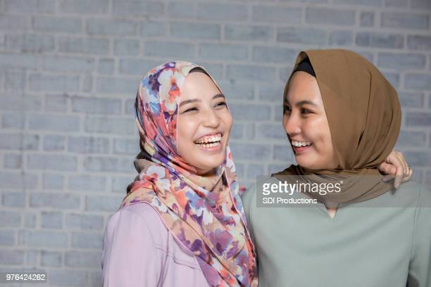 happy female friends - malay stock photos and pictures