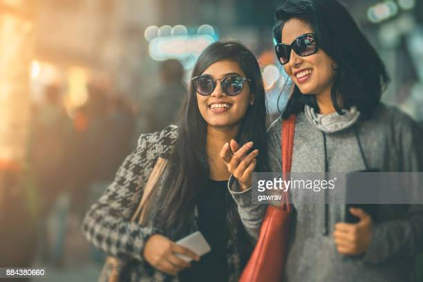 Happy female friends together in market.