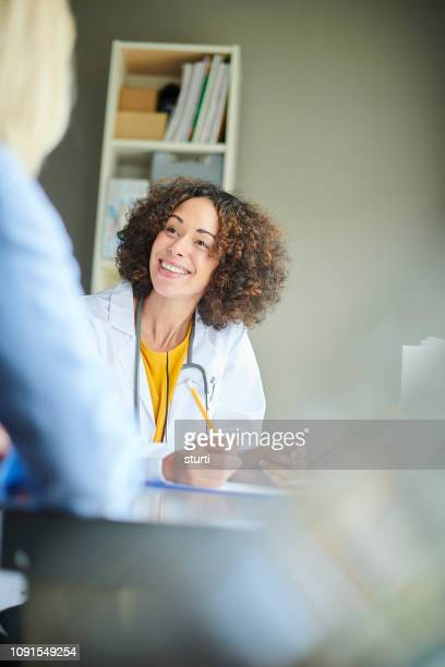 happy female gp - doctor's surgery stock pictures, royalty-free photos & images