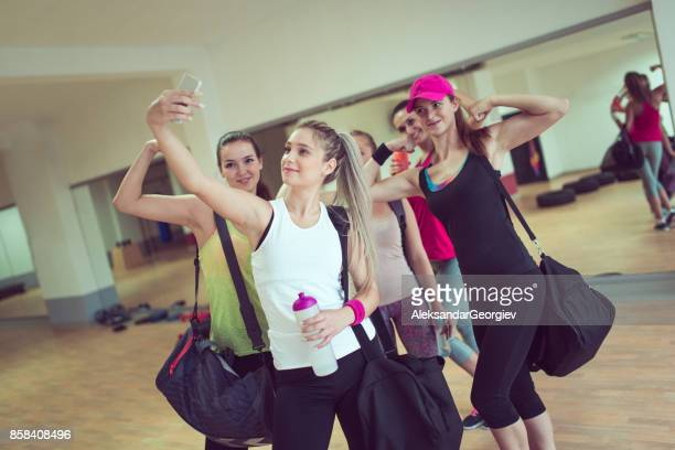 Happy Female Group Taking Selfie in Gym after Exercise
