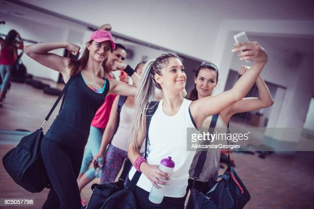 happy female group taking selfie in gym after exercise - cinque persone foto e immagini stock